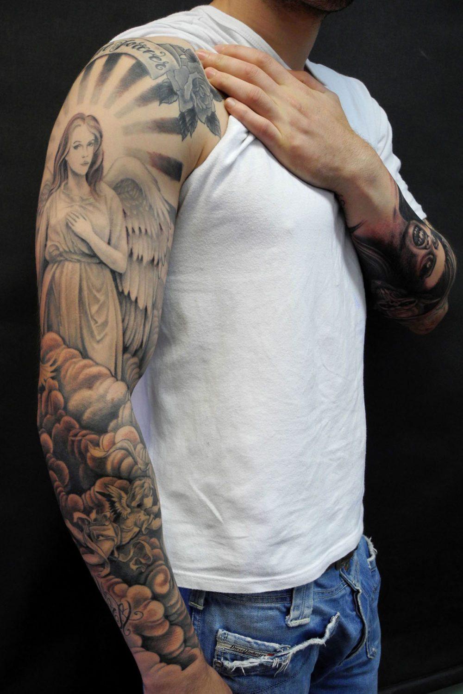 Black & Grey Religious/Spiritual Sleeve Tattoo