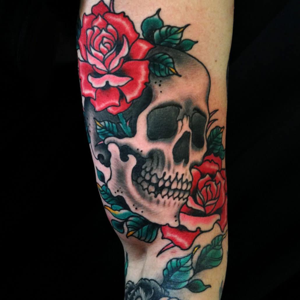 Arm Flowers Skull Tattoo